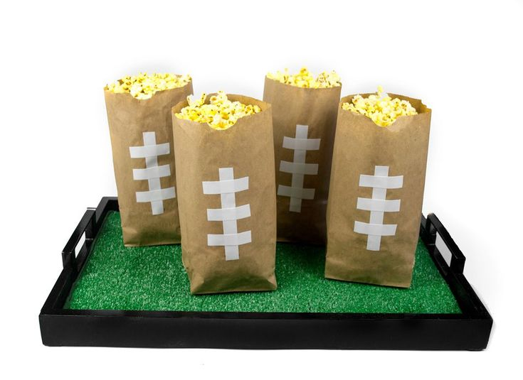 Keep your favorite Super Bowl watching snacks within easy reach with this quick DIY football snack bag that you can have the kids help out to make while you prep the tray and snacks to go in the bag.