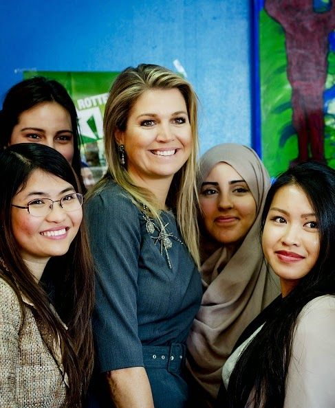 Dutch Queen Maxima (C) poses with students as she visits, as patroness of the Oranje Fonds, the 'Rotterdam's Got Talent' project in Rotterdam on Feb 13, 2015. This project, sponsored by the Oranje Fonds, guides school dropouts.