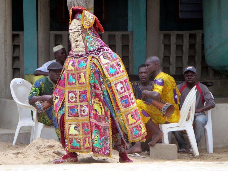 A voodoo dancer poses at Ganvie village on Lake Nokoue, near Cotonou, Benin.