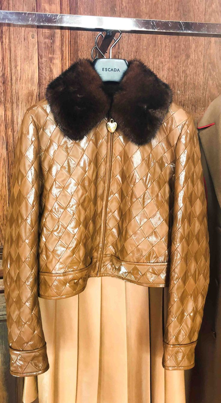 Brunette from Wall Street Escada brown leather and vinyl jacket