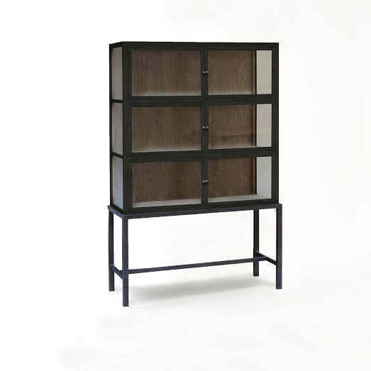 NEW! Made of reclaimed oak that bears the knots and imperfections of its previous life, the Curio Display Cabinet features a black finish that will serve as a perfectly rustic backdrop for all your collectibles.