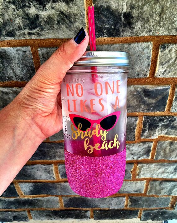 Of course no one likes a shady beach!! Get your tan on this summer and sip your drink of choice out of this adorable tumbler! All colors are customizable! Overview ♥ 24 ounce glass Mason Jar ♥ BPA Free, acrylic straw in a complimentary color included ♥ Also available as a 32 oz water bottle, 16 oz Coffee Mug or 11 oz Travel Mug ♥ Available with or without glitter ♥ Design is applied with high quality, permanent vinyl rated for outdoor use ♥ Glitter is sealed to prevent shedding  *Please…