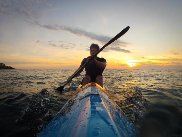 Nick Byrne out for a sunset surfski paddle session on Port Phillip Bay in Victoria, Australia.