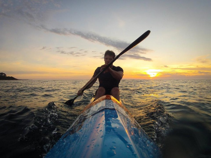 Nick Byrne out for a sunset surfski paddle session on Port Phillip Bay in Victoria, Australia.