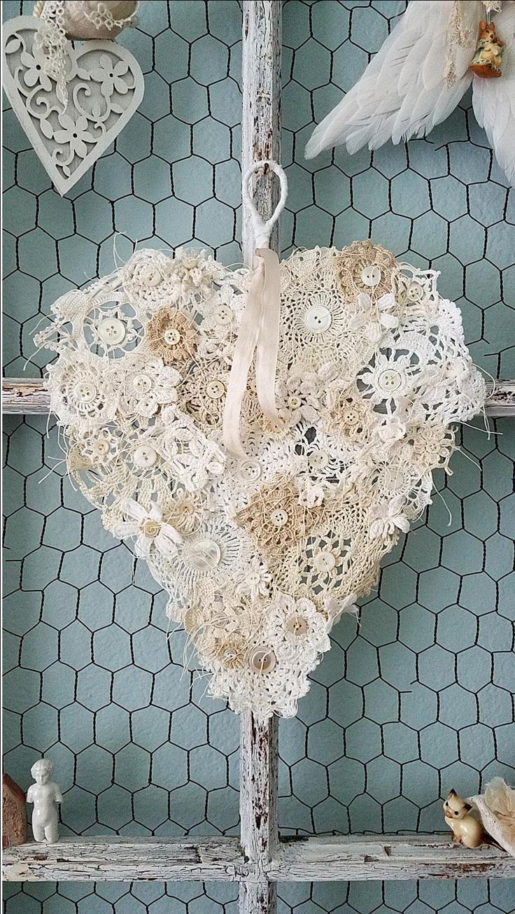 True Love HeartThis gorgeous heart is a Shabby Chic dream of a heart! An abandoned wire hanger was hand tugged and pulled into a not so perfect heart, like our own then wrapped with tattered an...