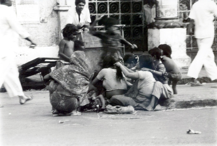 Grooming. We all love it. This was taken many years ago, at Crawford Market, in the town that was once called Bombay.     They have now renamed Crawford Market, and have given it a name that no one knows.