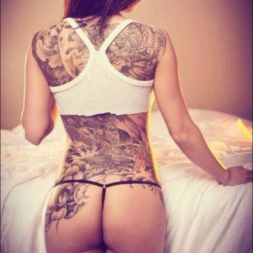 I love how her tattoo is on her whole back and goes onto her butt a little.