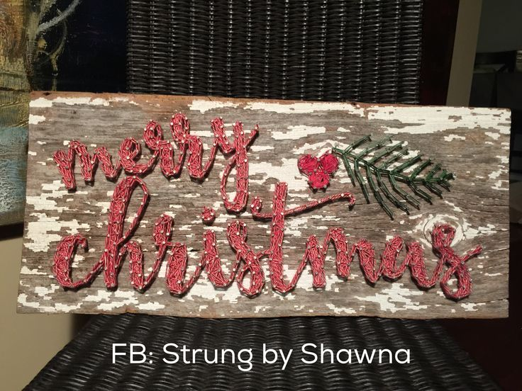Merry Christmas string art board I created. Find more at Strung by Shawna (FB and Instagram). This piece was made on barnwood from a 100 year salvaged barn here in Iowa. #stringart
