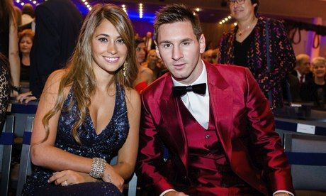 OK, not a bad player but would you seriously vote for a man in that suit? Lionel Messi and his wife Antonella at the Ballon d'Or awards. Pho...