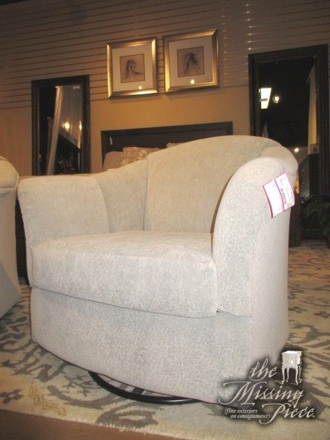 """Second of two currently available, this transitional style swivel rocker chair is done in a cool gray patterned upholstery. Rocks and turns with such ease! Very comfortable. 35""""W x 38""""D x 33""""H."""