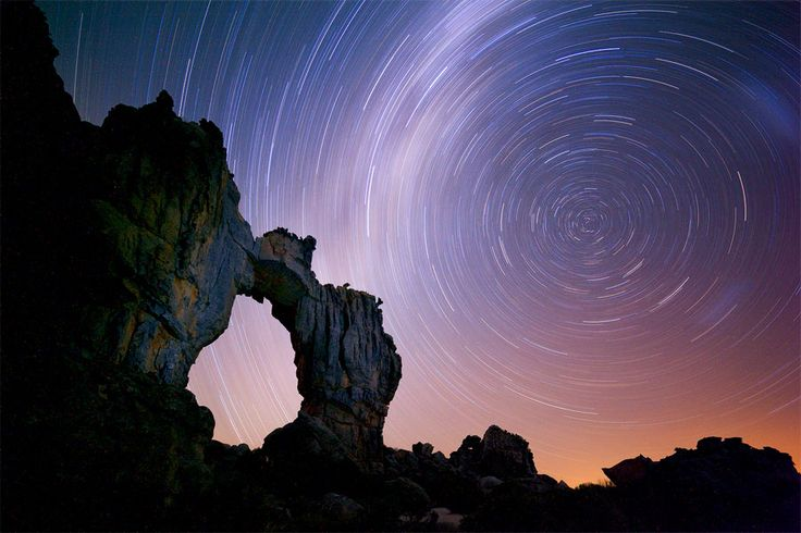 landscape photograph of a star trail long exposure over the wolfberg arch in the cederberg mountain range of south africa http://www.hougaardmalan.com