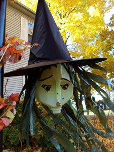 milk jug witch windsock - paint the milk jug with any face you like, cut a black trash bag for the hair, glue a witches hat on