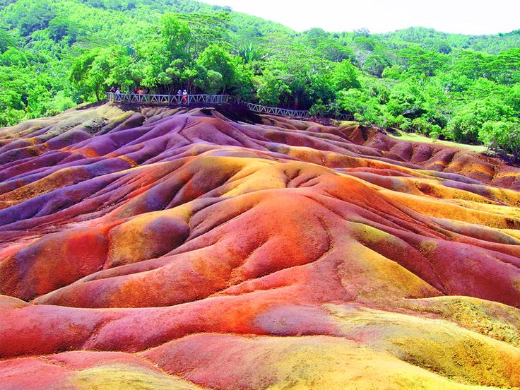 Seven Colored Earths, Chamarel in Mauritius is a popular sightseeing place where you actually see different layers of earth each of different colors including Red, Brown, Violet, Green, Blue, Purple and Yellow.