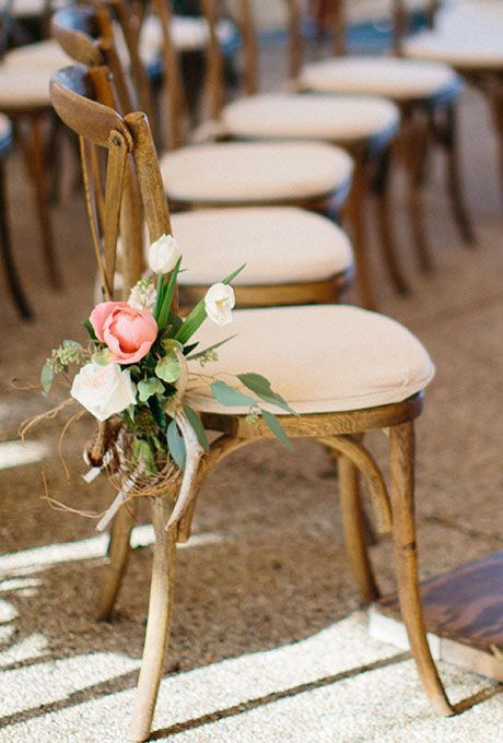 Pretty pink peony chair decoration paired with white tulips and blush roses. Photo: Megan Thiele   http://emmalinebride.com/ceremony/peony-aisle-decor/