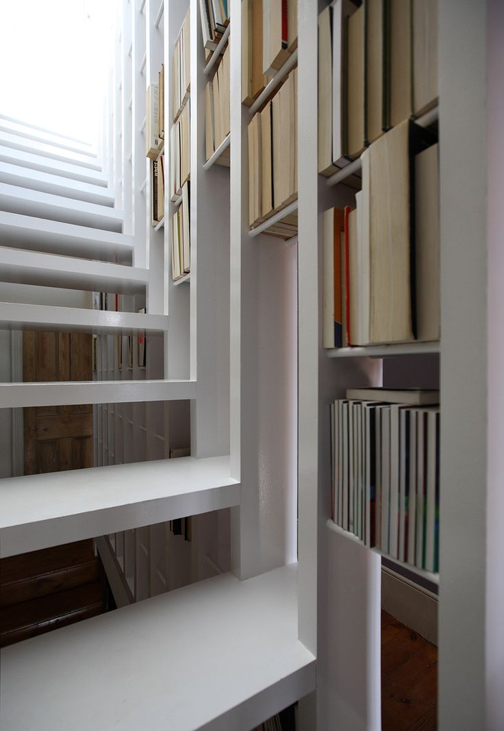 A new staircase does double duty as a bookcase. – MOCO LOCO