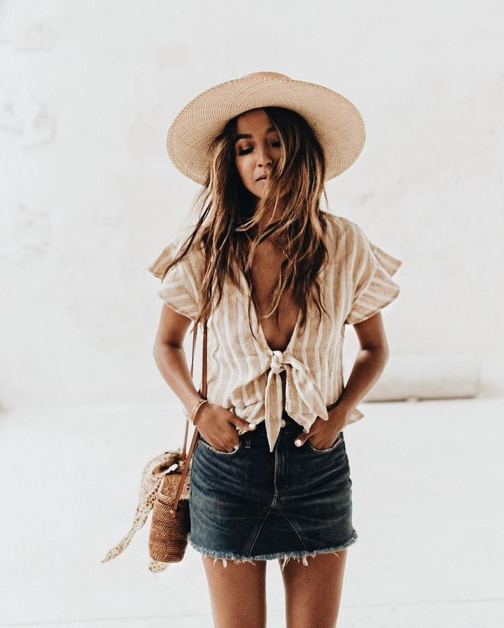 striped tan tie front short sleeve top with jean skirt and woven espadrille hat- casual spring break, beach, summer style outfit for women
