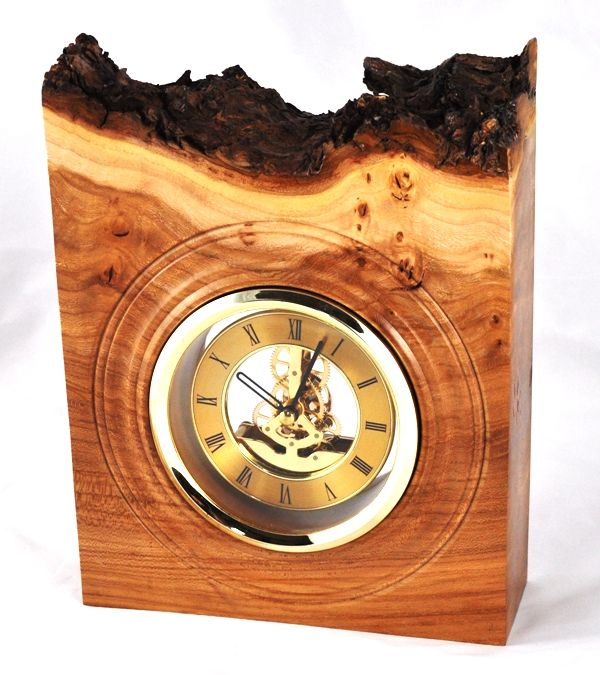 "Burr elm clock with natural edge bark retained. 5"" gold skeleton clock insert (quartz movement)."