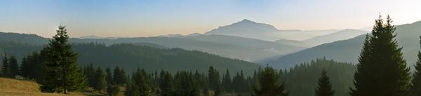 Wide panorama with mountains at sunset in late November. Photo taken in Neamt county - ROMANIA