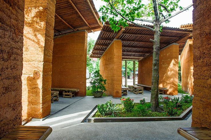 High thermal mass of rammed earth walls, lots of breeze, and ample shade from the bamboo roof equals a respite for summer hanging out. I love these little outdoor rooms that encourage smaller gathering groups but connect everyone. Rammed earth is made by tamping a mixture of clay & sand into forms. The tamping turns the mixture into sedimentary rock. Rammed earth is a high thermal mass material that can withstand weather. The color is from the iron oxide.