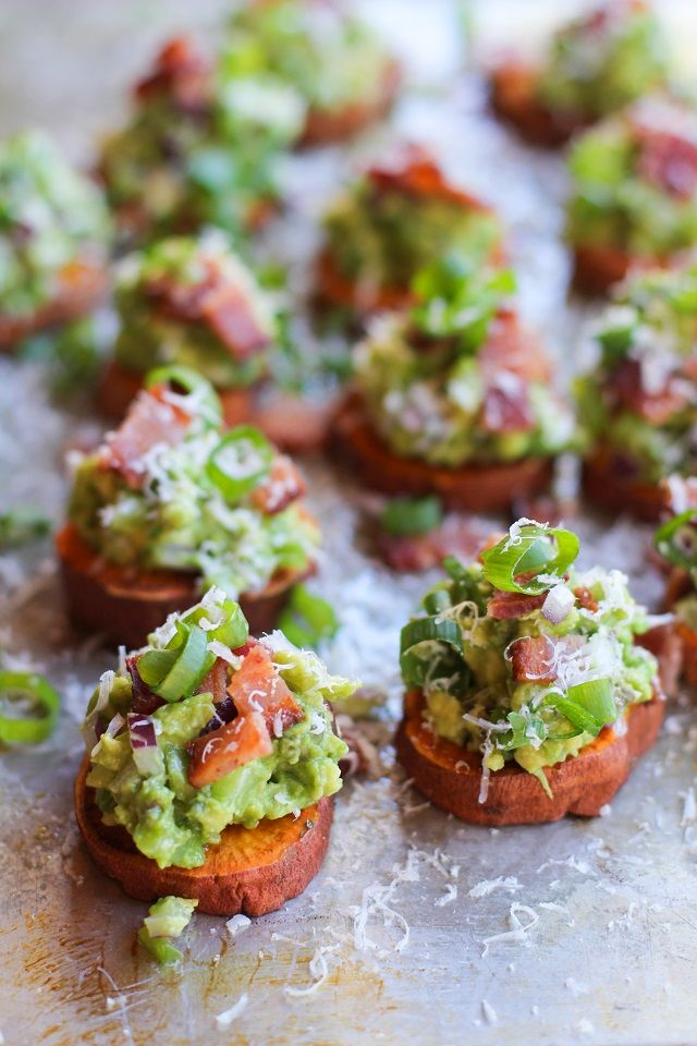 Roasted Sweet Potato Rounds with Guacamole and Bacon | theroastedroot.net #paleo #vegan #recipe #appetizer