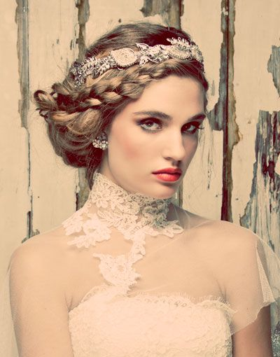 A Swarovski bejeweled Leaf Motif Wreath from Maria Elena accents an on-trend braided updo.