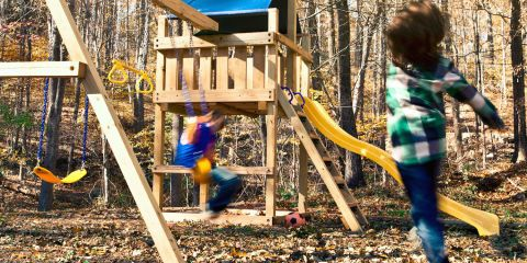 This classic backyard playground is made partly from a kit and partly from lumber you find and cut yourself. Follow these plans and in one weekend you'll be able to build a sturdy swing set for your kids, complete with wave slide, trapeze bar, sandbox, and more.
