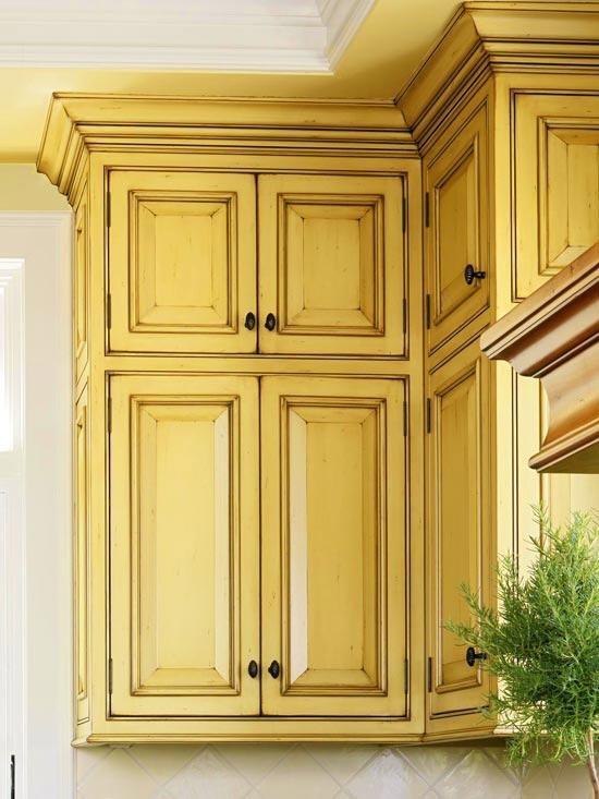 Gold antiqued kitchen cabinets.