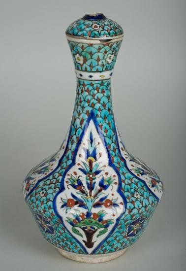 Antique Iznik pottery bottle and cover
