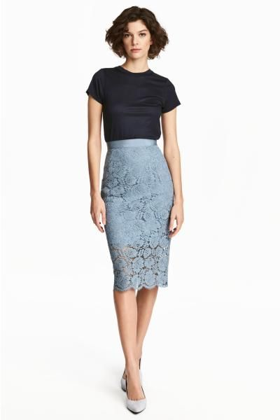 Calf-length, lace pencil skirt with grosgrain ribbon at the waist, concealed elastic at the side and a slit at the back. Lined.