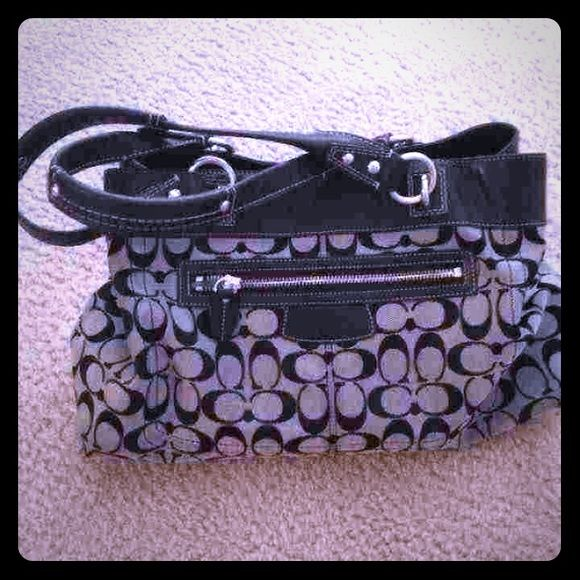 Coach Purse Large Has A Zip Pocket In Front Then Two Open
