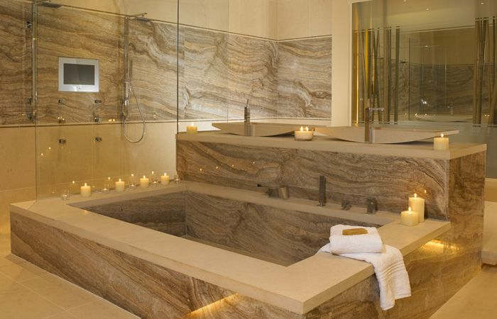 silver vein cut travertine bathroom- so the tub doesn't look comfortable - it sure is beautiful