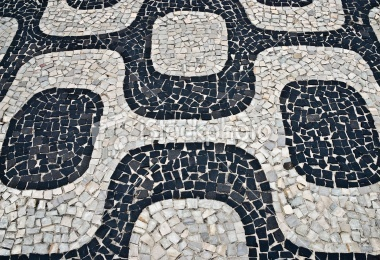 Common pattern specific from the Copacabana Beach in Rio de Janeiro, Brazil. Here the pattern is in a wall. It is said also to represent harmony between races; black and white living together in harmony.