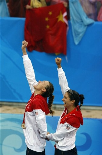 United States' Misty May-Treanor, right, and teammate Kerri Walsh raise their hands during the medal ceremony for women's beach volleyball at the Chaoyang Park Beach Volleyball Ground - Beijing Olympics 2008