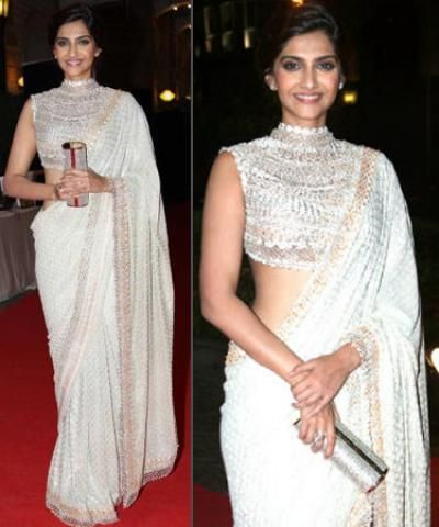 You can pair a plain saree with a richly-embroidered metallic choli for an exquisite ensemble