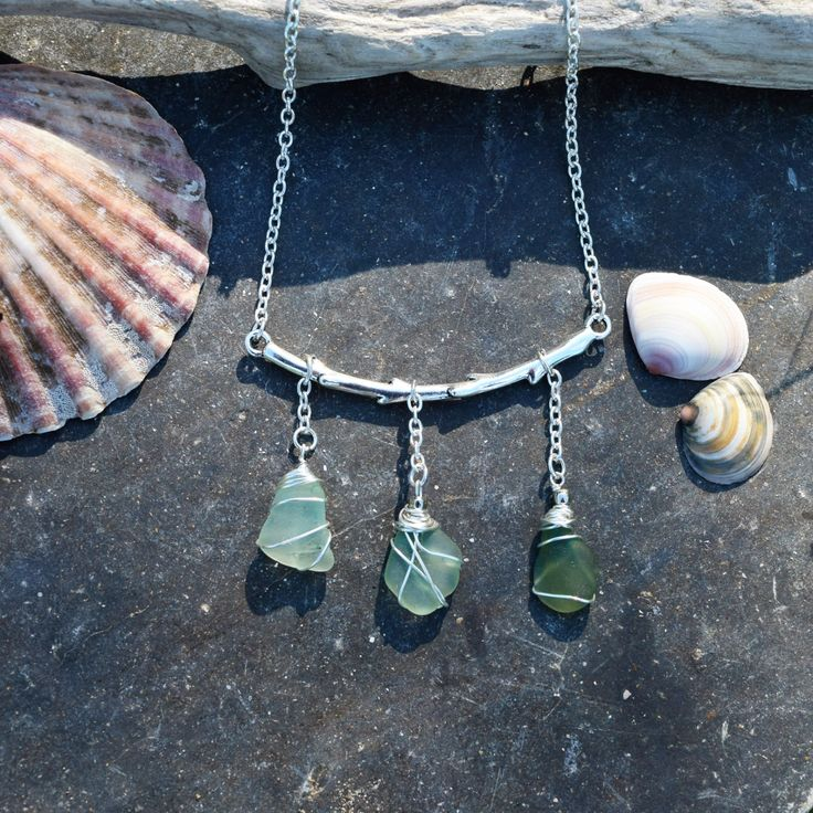 These pieces of seaglass graduate in strengthening tones of green and are wire wrapped as charms hanging from a silver twig in this quirky nature inspired piece. This nature necklace is romantic and earthy. I know that so many people, like me, feel the call of the sea and the salty breeze in their