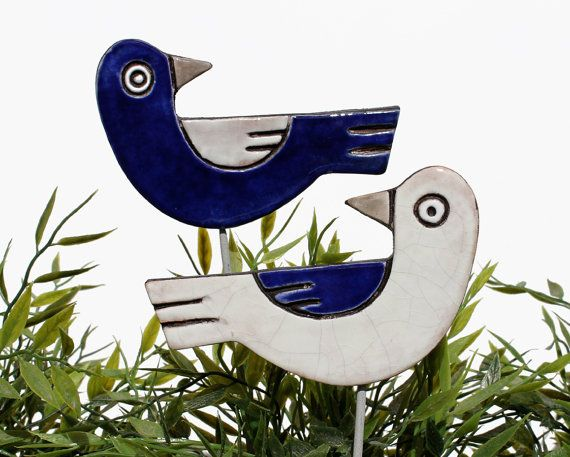Bird garden art made from ceramic.    Our ceramic plant stakes are fantastic small garden ideas, they also make great gifts. These garden decorations add a