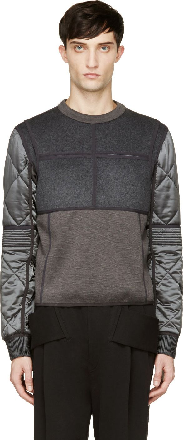 Long sleeve sweatshirt in tones of grey. Paneled throughout. Crewneck collar. Welt pockets at breast. Quilted sleeve with flap detail at elbow. Floating panel at shoulders. Zip closure at side seam. Ribbed sleeve cuffs. Fully lined. Tonal stitching.