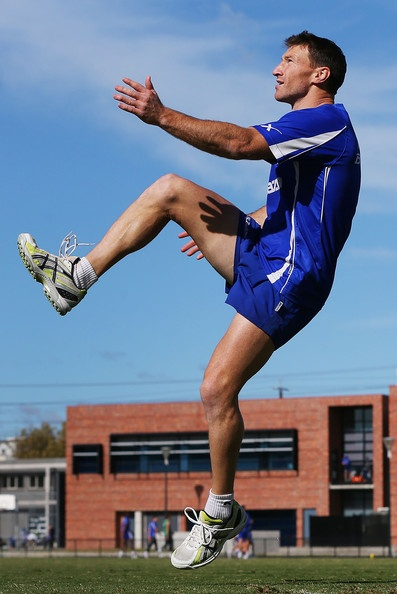 Brent Harvey kicks the ball during a North Melbourne Kangaroos AFL training session at Aegis Park on May 14, 2013 in Melbourne, Australia.