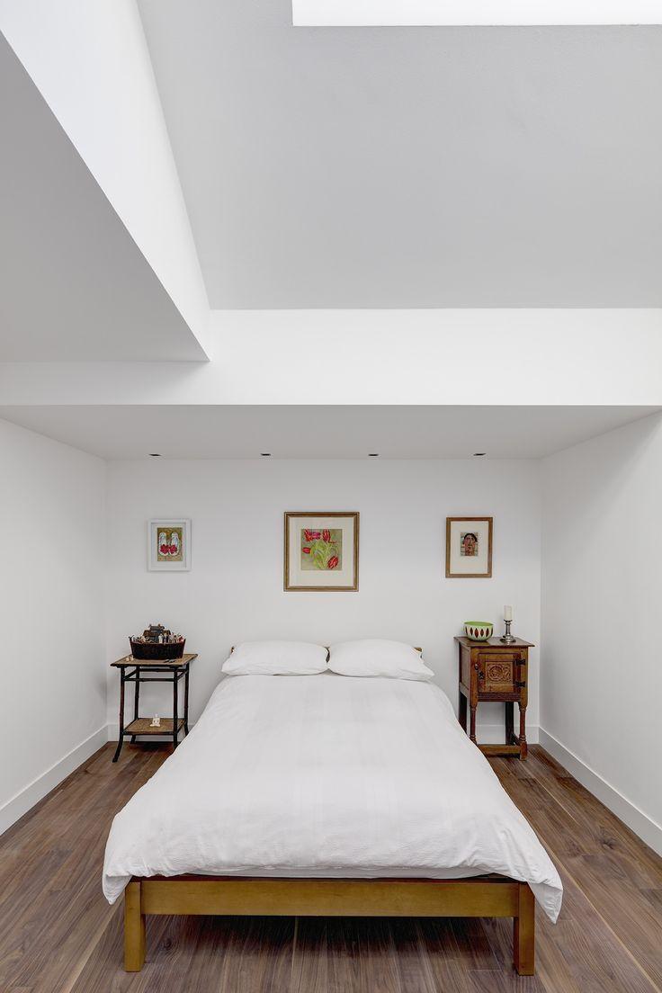 White on white bedroom. Jennifer Macrae oils.