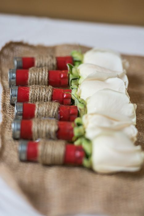 Shotgun shell boutonnieres. I wonder if they make black shells...