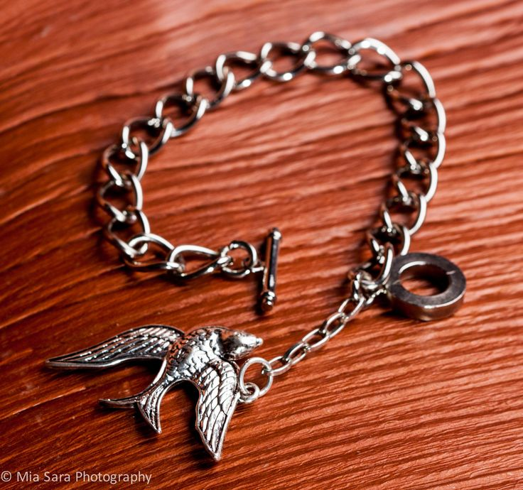 Chrome plated T bar wrist chain - with flying bird charm