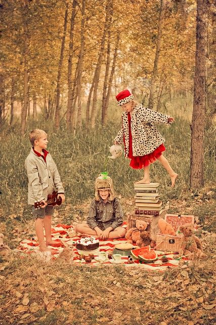 love the red and the animal print...and the idea of standing barefoot on a tall pile of books pouring tea into a cup that is balanced on a boy's head as another boy stands back and admires my talents. oh, and do i see cake?!