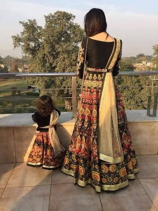 Mom and daughter from Pakistan in Pakistani dress .
