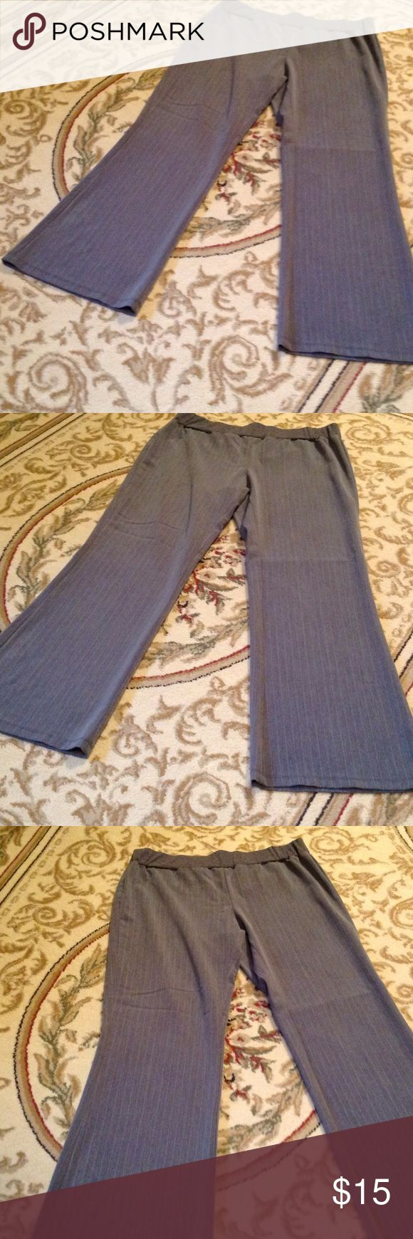 """Ladies size large pinstripe maternity pants Cute pinstripe gray & pink maternity pants in size large. Pull on design. Flared leg. In very good preowned condition. Measurements are as follows: waist 34"""", hips 46"""", waist to floor 38"""", inseam 30"""". b sport Pants Trousers"""
