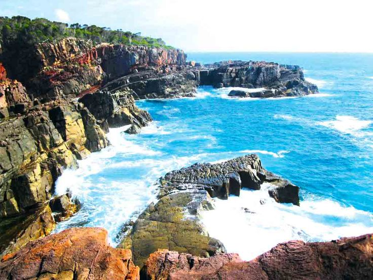 Eden, NSW South Coast. Atop a headland between two bays, this apartment complex overlooks the ocean and is less than a 15-minute walk to nearby Aslings or Cocora Beach. Between September and December these surrounding waters are a hot spot for whale watching