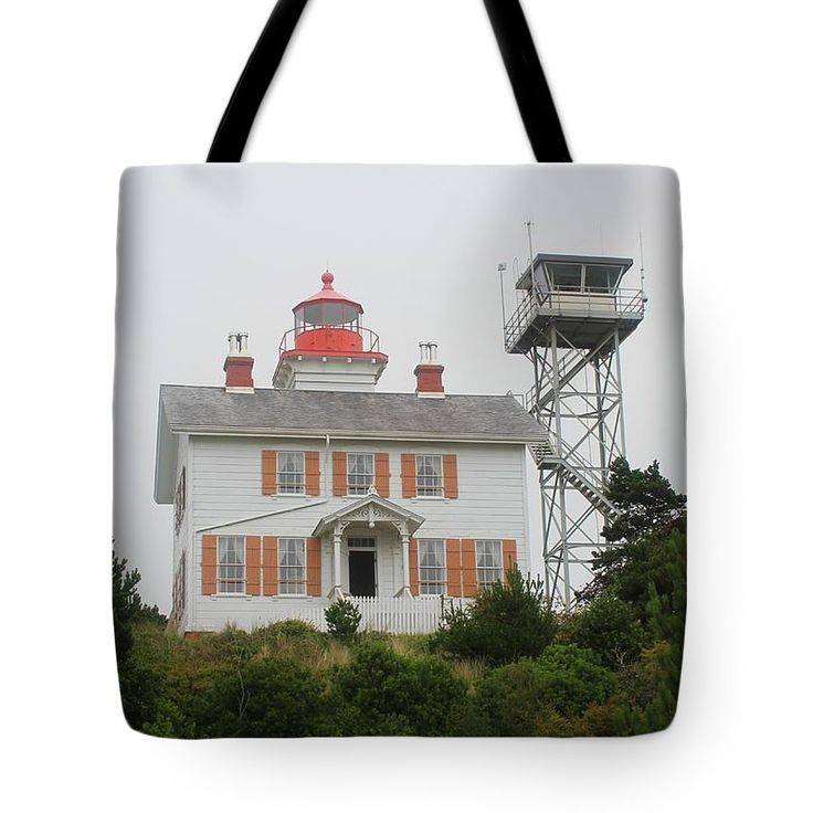 Light House Oregon Coast Tote Bag by Tom Janca.  The tote bag is machine washable, available in three different sizes, and includes a black strap for easy carrying on your shoulder.  All totes are available for worldwide shipping and include a money-back guarantee.