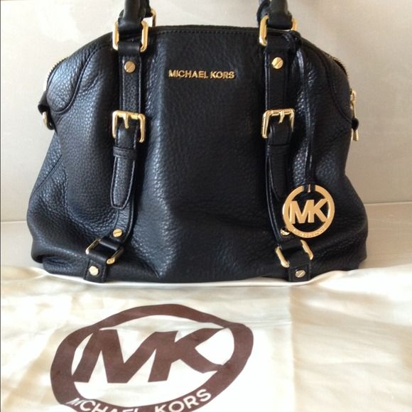 Authentic Michael Kors black handbag LIKE NEW! Black leather handbag with gold hardware. Can be converted into a cross body! Extremely lightly used! Price is firm because it's an excellent condition and a huge drop from original price. Thanks Michael Kors Bags