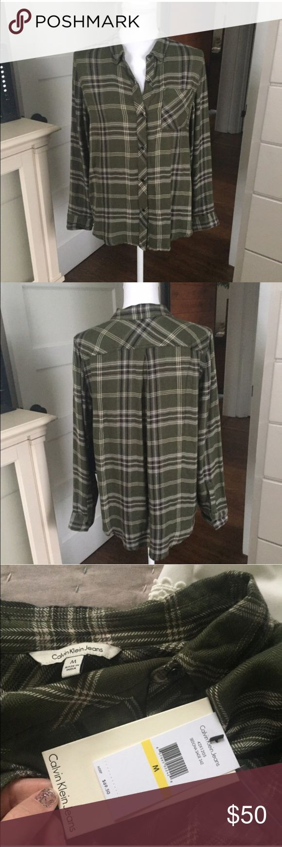 NWT Calvin Klein Jeans flannel medium-cute & comfy NWT Calvin Klein Jeans flannel medium-super cute and comfy! A little longer in the back so it looks really cute with leggings or skinny jeans!! Calvin Klein Jeans Tops