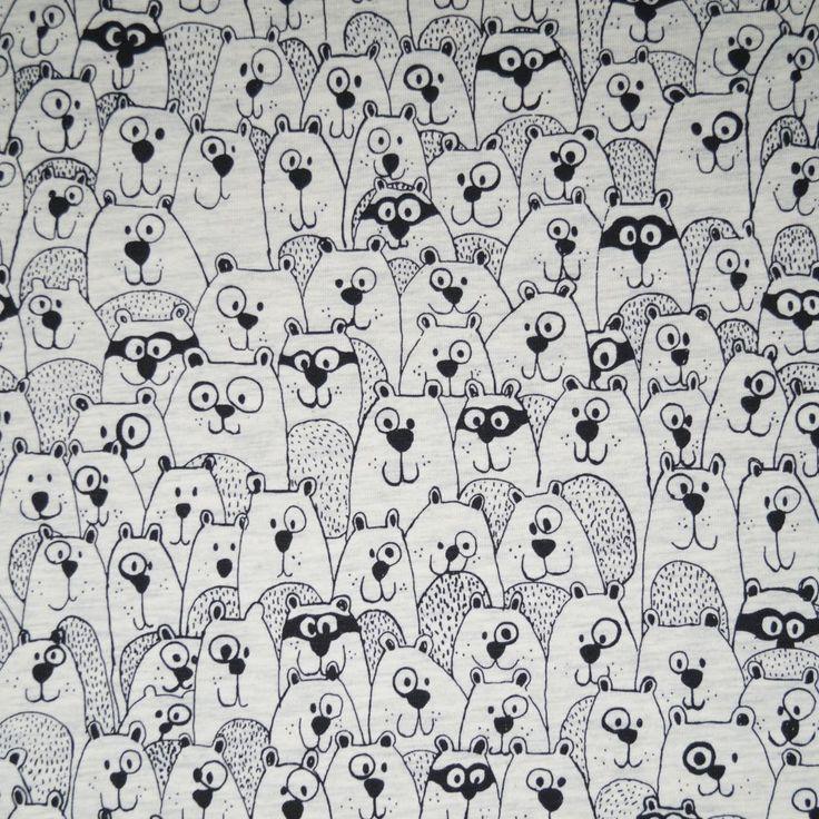 Wolwit gemêleerde tricot met zwart omlijnde beren. 60% katoen 35% polyester 5% lycra. Leuk voor een shirt of zomerse trui!