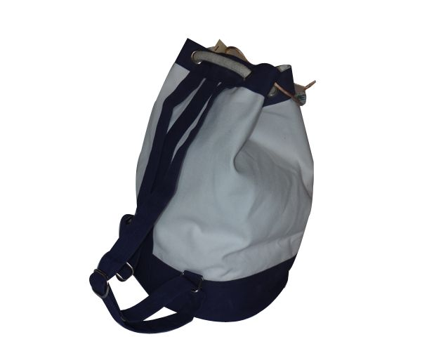 Canvas backpack with rope and eyelet, also handle for carrying at back. This bag can be used as school bag and travel bag also.